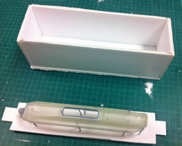 A silicone mold pattern and mold box are ready for pouring